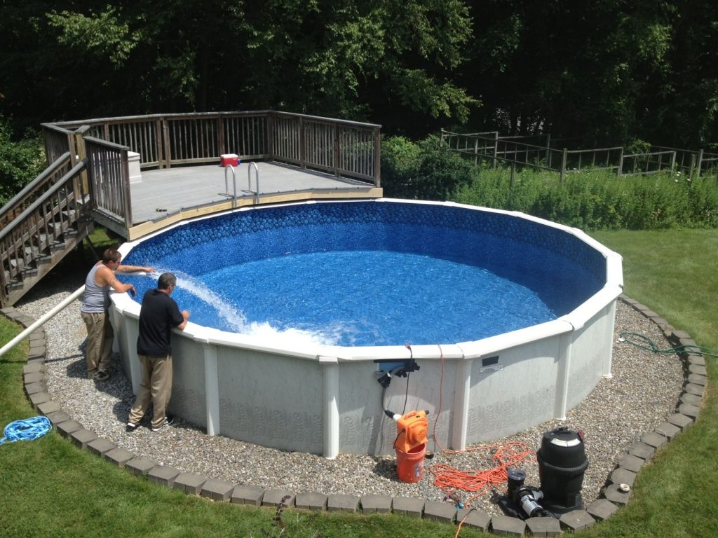 how to level an above ground pool with water in it